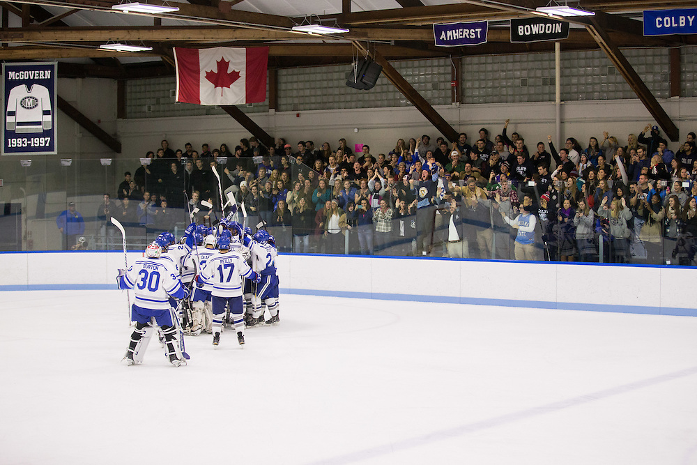 Colby College Men's Hockey celebrates after a win in a NCAA Division III hockey game between Colby College and Bowdoin College on December 4, 2015 at Alfond Rink on the campus of Colby College in Waterville, ME.  (Dustin Satloff)