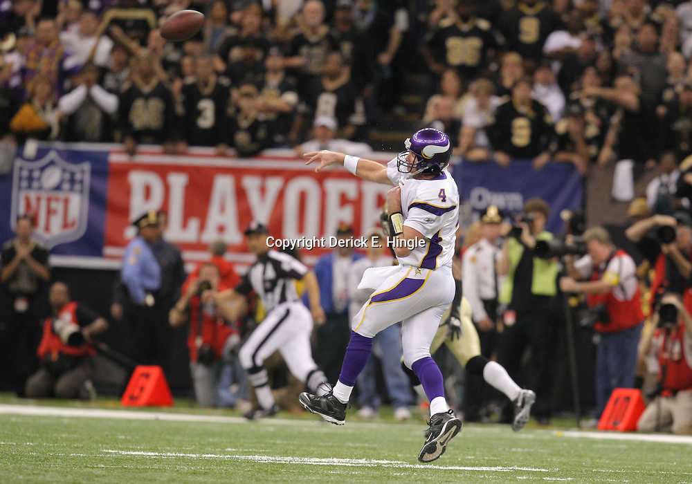 Jan 24, 2010; New Orleans, LA, USA; Minnesota Vikings quarterback Brett Favre (4) throws a pass in the fourth quarter that was intercepted by New Orleans Saints cornerback Tracy Porter (not pictured) during a 31-28 overtime victory by the New Orleans Saints over the Minnesota Vikings in the 2010 NFC Championship game at the Louisiana Superdome. Mandatory Credit: Derick E. Hingle-US PRESSWIRE