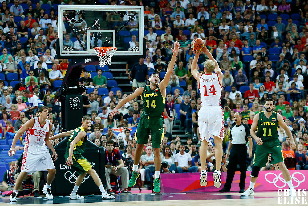 08 August 2012: Russia Anton Ponkrashov takes a three points jumpshot over Lithuania Jonas Valanciunas during 83-74 Team Russia victory over Team Lithuania, during the men's basketball quarter-finals, at the 02 Arena, in London, Great Britain.