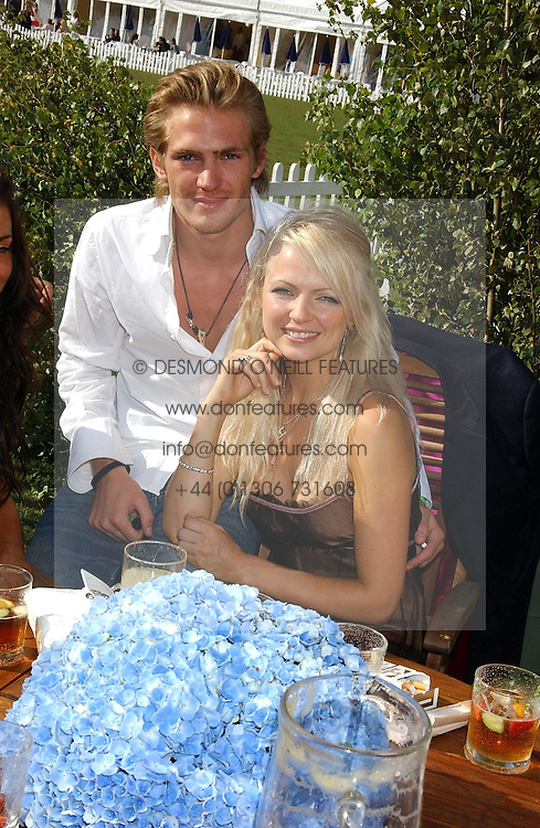 JACOBI ANSTRUTHER-GOUGH-CALTHORPE and HANNAH SANDLING at the 2005 Cartier International Polo between England &amp; Australia held at Guards Polo Club, Smith's Lawn, Windsor Great Park, Berkshire on 24th July 2005.<br />