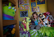 McKenzie (6) reads to her teddies in her bedroom at home in Shefield UK Tuesday, Aug. 12, 2014The D'Arby family is involved in the FAST  (Families and Schools Together) program which encourages parents to read to their children at home.(Elizabeth Dalziel for Save the Children )