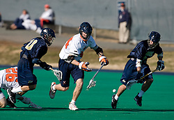 Virginia defenseman Mike Timms (44) scoops up a loose ball.  The Virginia Cavaliers scrimmaged the Navy Midshipmen in lacrosse at the University Hall Turf Field  in Charlottesville, VA on February 2, 2008.