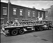 Coill Dubh Childrens Band   (F16)..1973..03.06.1973..06.03.1973..3rd June 1973..At The Fleadh Nua Parade in Dublin,Bord Na Mona sponsored Scoil Náisiúnta,Coill Dubh,CillDara,Childrens Band. The band comprised of 33 children was ferried through Dublin streets aboard the sponsors lorry..Journeys end, The Coill Dubh Childrens Band are pictured relaxing at the end of the Fleadh Nua route.