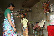 Budhia Singh, (right) 6, the famous Limca World Record marathoner, is arguing with his mother, Sukanti Singh, 37, (left) in the house where they now live situated inside Salia Sahi slum (pop. 30.000) of Bhubaneswar, the capital of Orissa State, on Friday, May 16, 2008. On May 1, 2006, Budhia completed a record breaking 65 km run from Jagannath temple, Puri to Bhubaneswar. He was accompanied by his coach Biranchi Das and by the Central Reserve Police Force (CRPF). On 8th May 2006, a Government statement had ordered that he stopped running. The announcement came after doctors found the boy had high blood pressure and cardiological stress. As of 13th August 2007 Budhia's coach Biranchi Das was arrested by Indian police on suspicion of torture. Singh has accused his coach of beating him and withholding food. Das says Singh's family are making up charges as a result of a few petty rows. On April 13, Biranchi Das was shot dead in Bhubaneswar, in what is believed to be an event unconnected with Budhia, although the police is investigating the case and has made an arrest, a local goon named Raja Archary, which is now in police custody. **Italy and China Out**