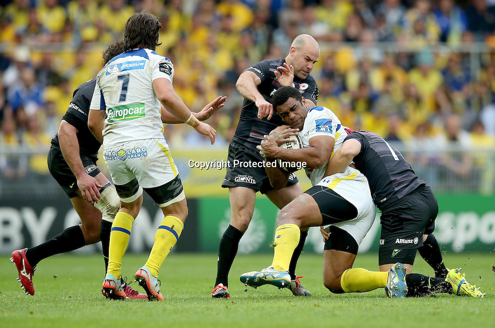 European Rugby Champions Cup Semi-Final, Stade Geoffroy-Guichard, Saint-Etienne, France 18/4/2015<br /> ASM Clermont Auvergne vs Saracens<br /> Saracens's Charlie Hodgson and Schalk Brits tackle Naipolioni Nalaga of Clermont<br /> Mandatory Credit &copy;INPHO/James Crombie
