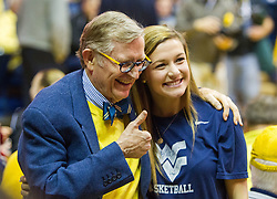 Jan 18, 2017; Morgantown, WV, USA; West Virginia Mountaineers president Gordon Gee takes a picture with a West Virginia Mountaineers student during halftime at WVU Coliseum. Mandatory Credit: Ben Queen-USA TODAY Sports