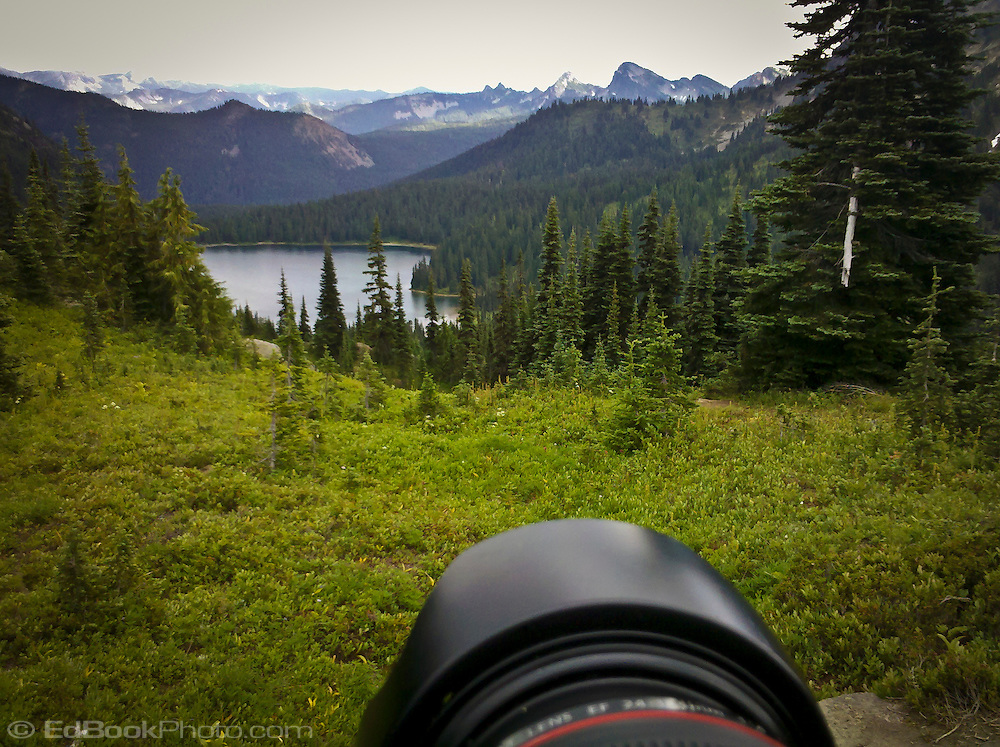 looking over an SLR lens into the William O. Douglas Wilderness, Wenathee National Forest, at Dewey Lake and mountains of the Cascade Range, Washington state, USA.