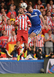 30.04.2014, Stamford Bridge, London, ENG, UEFA CL, FC Chelsea vs Atletico Madrid, Halbfinale, Rueckspiel, im Bild Chelsea's defender Branislav Ivanovic and Athletico Madrid's forward Adrian Lopez compete for the ball // Chelsea's defender Branislav Ivanovic and Athletico Madrid's forward Adrian Lopez compete for the ball during the UEFA Champions League Round of 4, 2nd Leg Match between Chelsea FC and Club Atletico de Madrid at the Stamford Bridge in London, Great Britain on 2014/05/01. EXPA Pictures &copy; 2014, PhotoCredit: EXPA/ Mitchell Gunn<br /> <br /> *****ATTENTION - OUT of GBR*****