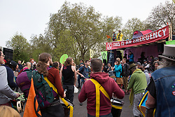 London, UK. 23rd April 2019. The XR Samba Band entertains climate change activists from Extinction Rebellion at an assembly at Marble Arch during a Metropolitan Police operation to surround the stage.