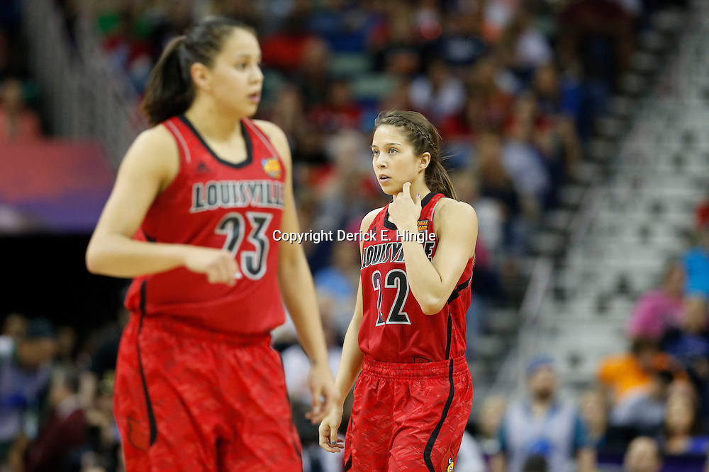 Apr 9, 2013; New Orleans, LA, USA; Louisville Cardinals guard Shoni Schimmel (23) and guard Jude Schimmel (22) look on during the first half of the championship game in the 2013 NCAA womens Final Four against the Connecticut Huskies at the New Orleans Arena. Mandatory Credit: Derick E. Hingle-USA TODAY Sports