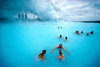 Icelanders soaking in the Blue Lagoon at the Svartsengi Geothermal power plant, near Keflavik, Iceland
