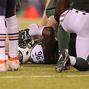 Muhammad Wilkerson, New York Jets, injured during the New York Jets Vs Chicago Bears, NFL regular season game at MetLife Stadium, East Rutherford, NJ, USA. 22nd September 2014. Photo Tim Clayton for the New York Times