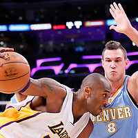 23 November 2014: Los Angeles Lakers guard Kobe Bryant (24) drives past Denver Nuggets forward Danilo Gallinari (8) during the Los Angeles Lakers season game versus the Denver Nuggets, at the Staples Center, Los Angeles, California, USA.