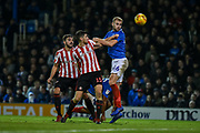 Portsmouth Defender, Jack Whatmough (16) wins a header during the EFL Sky Bet League 1 match between Portsmouth and Sunderland at Fratton Park, Portsmouth, England on 22 December 2018.