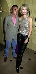 MR A A GILL and MISS NICOLA FORMBY, at a party in London on 1st October 2000.OHM 161