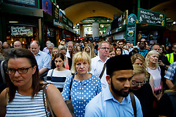 © Licensed to London News Pictures. 14/06/2017. London, UK. One minutes silence is observed in Borough Market, London as it reopens on 14 June 2017, following a terror attack that killed 8 people over a week ago. Photo credit: Tolga Akmen/LNP
