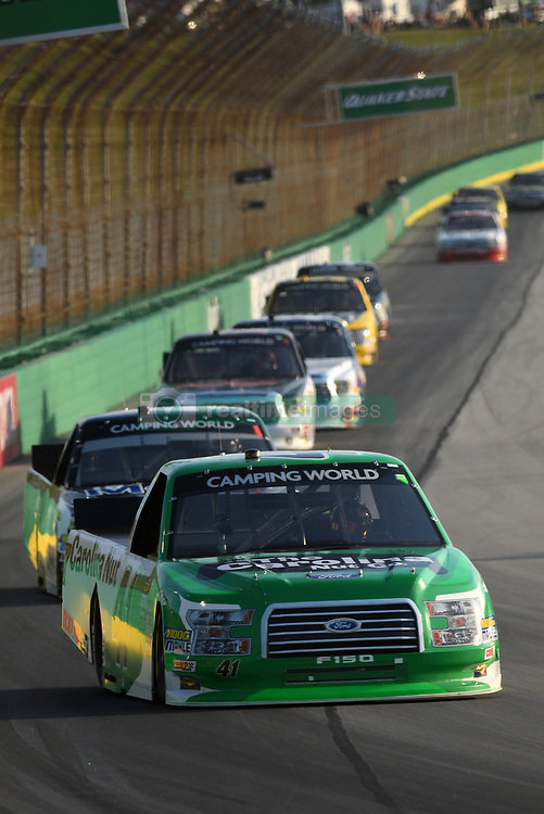 July 12, 2018 - Sparta, KY, U.S. - SPARTA, KY - JULY 12: Ben Rhodes (41) ThorSport Racing Ford F-150 leads a pack of trucks down the back stretch during the NASCAR Camping World Truck Series Buckle Up In Your Truck 225 on July 12th, 2018, at Kentucky Speedway in Sparta, Kentucky. (Photo by Michael Allio/Icon Sportswire) (Credit Image: © Michael Allio/Icon SMI via ZUMA Press)