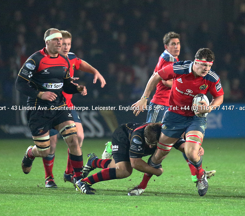 Guinness PRO12, Rodney Parade, Wales 21/11/2014<br /> Newport Gwent Dragons vs Munster <br /> Munster's Robin Copeland is tackled by Dragons' Lewis Evans <br /> Mandatory Credit &copy;INPHO/Simon King