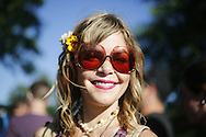 06212016 - Noblesville, Indiana, USA: A Dead and Company fan with flowers in her hair and rose colored glasses smiles in the parking lot of Klipsch Music Center (Deer Creek) before members of the Grateful Dead perform as Dead and Company. The Grateful Dead's final show at  Deer Creek in July 1995 was marred by over a thousand fans crashing the gates leading to the next day's show being canceled. Grateful Dead guitarist Jerry Garcia died a few weeks later. (Jeremy Hogan/Polaris)