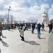 Tourists visiting the Martin Luther King Memorial in Washington DC. At right is a statue of King sculpted by Lei Yixin, part of a section of the memorial dubbed the Stone of Hope.