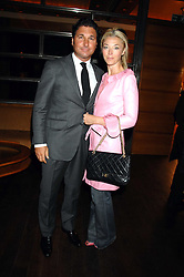 TAMARA BECKWITH and her husband GEORGE VERONI  at a party to celebrate the launch of Cavalli Selection - the first ever wine from Casa Cavalli, held at 17 Berkeley Street, London W1 on 29th May 2008.<br />