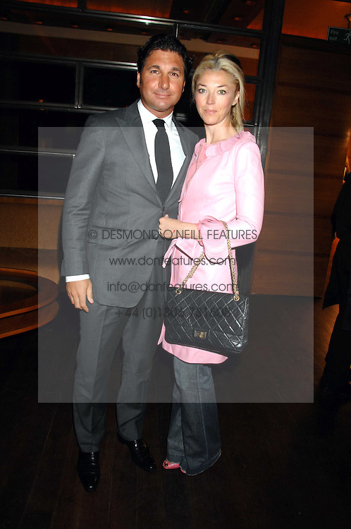 TAMARA BECKWITH and her husband GEORGE VERONI  at a party to celebrate the launch of Cavalli Selection - the first ever wine from Casa Cavalli, held at 17 Berkeley Street, London W1 on 29th May 2008.<br /><br />NON EXCLUSIVE - WORLD RIGHTS