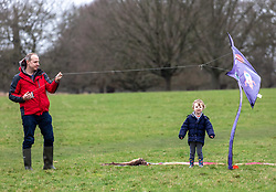 © Licensed to London News Pictures. 15/02/2020. London, UK. The Shepherd family from Barnes enjoy the windy conditions to fly a kite in Richmond Park as Storm Dennis hits London and the South East with high winds and heavy rain forecast for the weekend. Photo credit: Alex Lentati/LNP
