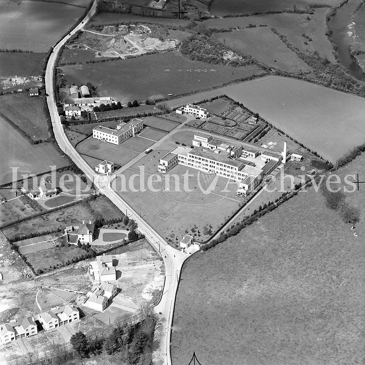 A234 Kilkenny County Hospital.    (Part of the Independent Newspapers Ireland/NLI collection.)<br /> <br /> <br /> These aerial views of Ireland from the Morgan Collection were taken during the mid-1950's, comprising medium and low altitude black-and-white birds-eye views of places and events, many of which were commissioned by clients. From 1951 to 1958 a different aerial picture was published each Friday in the Irish Independent in a series called, 'Views from the Air'.<br /> The photographer was Alexander 'Monkey' Campbell Morgan (1919-1958). Born in London and part of the Royal Artillery Air Corps, on leaving the army he started Aerophotos in Ireland. He was killed when, on business, his plane crashed flying from Shannon.