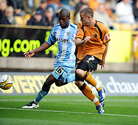 Molineux Wolverhampton v Coventry (2-1)  Championship 18/10/2008<br /> Michael Kightly (Wolves) Isaac Orourne (Coventry) <br /> Photo Roger Parker Fotosports International