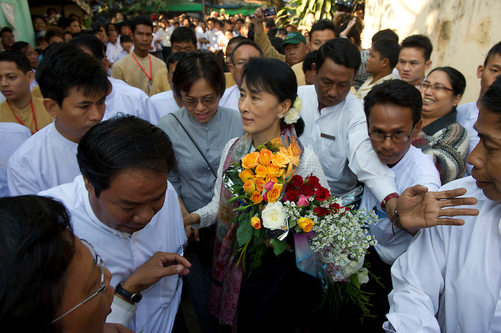 The National League of Democracy (NLD) head, Pro-democracy leader Aung San Suu Kyi is mobbed by supporters as she visits the home of the family of Ute Ma We, a man who died in prison some twenty years ago. January 18th 2012.