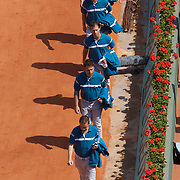 Line judges march onto the court during the French Open Tennis Tournament at Roland Garros, Paris, France on Monday, June 1, 2009. Photo Tim Clayton.