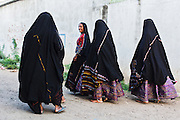 Women of the village dressed in traditional clothes going to attend the wedding of their friend.