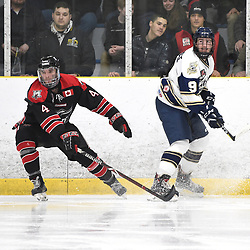 TORONTO, ON  - APR 10,  2018: Ontario Junior Hockey League, South West Conference Championship Series. Game seven of the best of seven series between Georgetown Raiders and the Toronto Patriots. Zac Elson #4 of the Georgetown Raiders and Maxwell Routledge #9 of the Toronto Patriots follow the play during the second period.<br /> (Photo by Andy Corneau / OJHL Images)