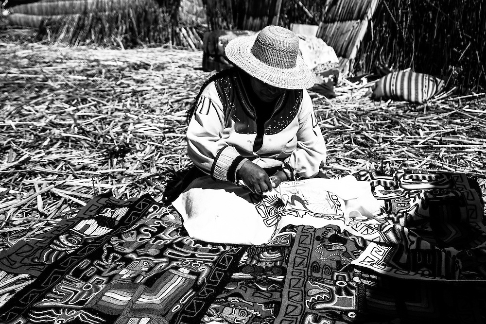 Where: Lake Titicaca, Peru<br /> A local lady sews her wares to sell.