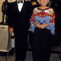 Actor Larry Hagman escorts his wife Maj at the White House on February 28, 1984.