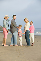 Family standing on beach, portrait