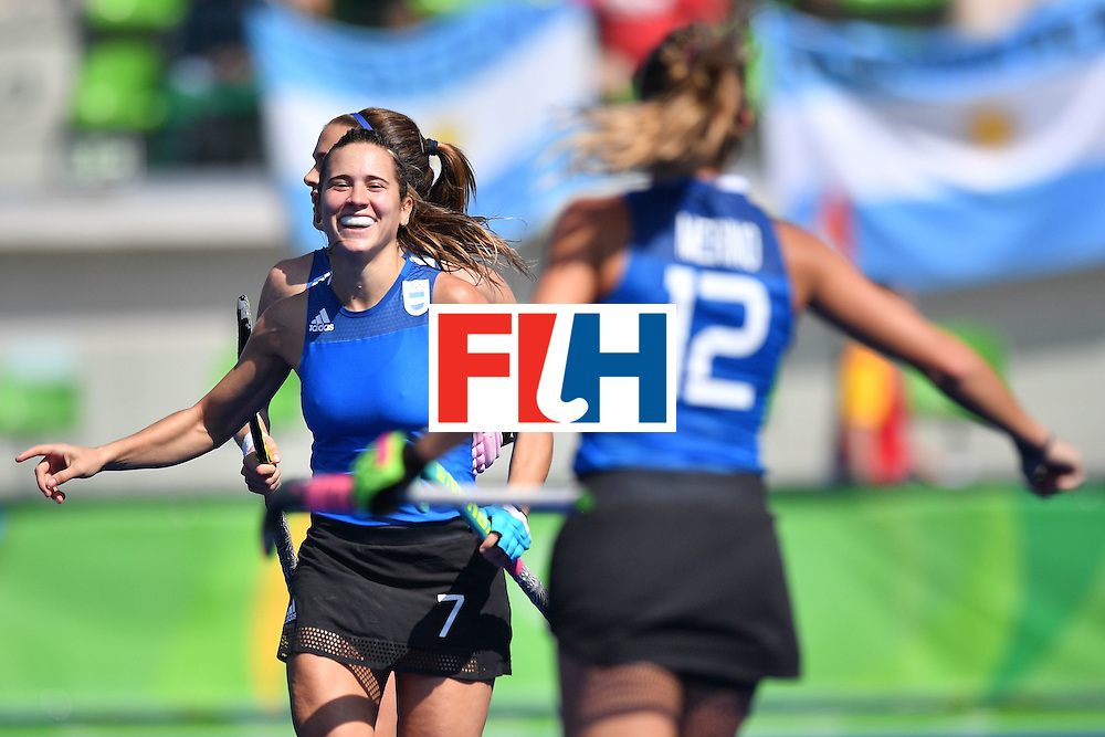 Argentina's Martina Cavallero (C) celebrates scoring with her team-mates during the women's field hockey Argentina vs India match of the Rio 2016 Olympics Games at the Olympic Hockey Centre in Rio de Janeiro on August, 13 2016. / AFP / Carl DE SOUZA        (Photo credit should read CARL DE SOUZA/AFP/Getty Images)