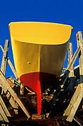 Colorful sailboat drydocked for repair, Martha's Vineyard, Massachusetts, USA