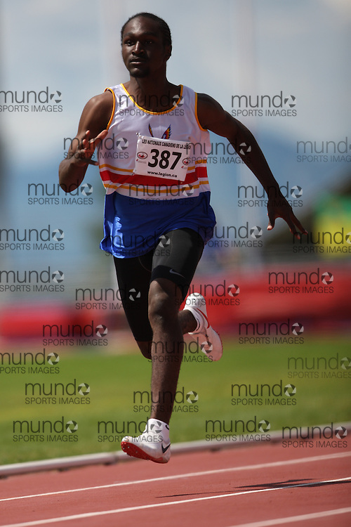 Sherbrooke, Quebec ---08/08/09---  Marlon Laidlaw-Allen of Phoenix Athletics Assoc. competes in the 100 metres at the 2009 Legion Canadian Youth Track and Field Championships in Sherbrooke, Quebec, August 10, 2009..HO/ Athletics Canada (credit should read GEOFF ROBINS/Mundo Sport Images/ Athletics Canada)..