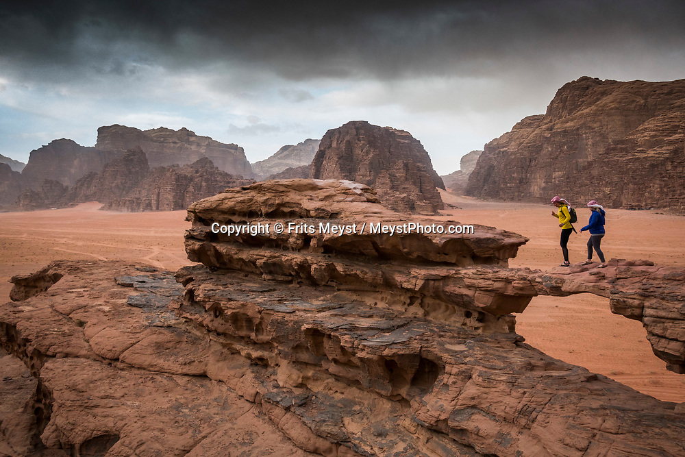 Dana, Petra, Wadi Rum, Jordan, April 2019. Wadi Rum is a protected desert wilderness in southern Jordan. It features dramatic sandstone mountains like the many-domed Jebel Um Ishrin, and natural arches such as Burdah Rock Bridge. Many prehistoric inscriptions and carvings line rocky caverns and steep chasms, such as Khazali Canyon. The natural watering hole of Lawrence's Spring is named after British soldier Lawrence of Arabia, who allegedly washed there. The Kingdom of Jordan is hosts one of the most accessible desert wildernesses of the Middle East, with a rich Bedouin culture. Photo by Frits Meyst / Meystphoto.com