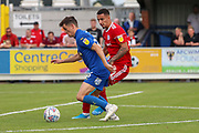 AFC Wimbledon midfielder Callum Reilly (33) dribbling into box during the EFL Sky Bet League 1 match between AFC Wimbledon and Accrington Stanley at the Cherry Red Records Stadium, Kingston, England on 17 August 2019.