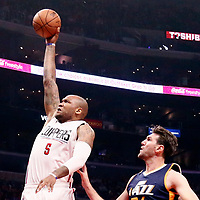 25 March 2016: LA Clippers center Marreese Speights (5) goes for the dunk past Utah Jazz center Jeff Withey (24) during the Los Angeles Clippers 108-95 victory over the Utah Jazz, at the Staples Center, Los Angeles, California, USA.