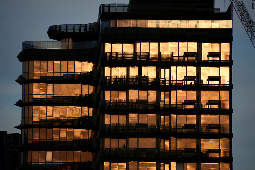 Reflections of a sunset in an Office Block and windows in a vibrant Yellow Orange colour