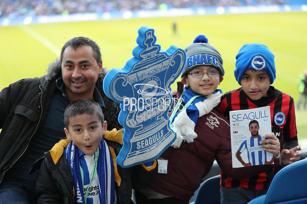 football fans, football supporters with foam FA Cup during the The FA Cup match between Brighton and Hove Albion and Milton Keynes Dons at the American Express Community Stadium, Brighton and Hove, England on 7 January 2017.