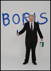The Mayor of London Boris Johnson painting his name on the studio background during a portrait shoot in the studio, London, United Kingdom. Friday, 30th March 2012. Picture by Andrew Parsons / i-Images