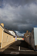 "Rainclouds over coloured houses on street, Kilkee, Co. Clare, Ireland This mage can be licensed via Millennium Images. Contact me for more details, or email mail@milim.com For prints, contact me, or click ""add to cart"" to some standard print options."