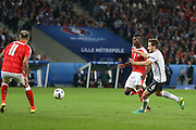 Switzerland Forward Breel Embolo battles with France Midfielder Yohan Cabaye during the Euro 2016 Group A match between Switzerland and France at Stade Pierre Mauroy, Lille, France on 19 June 2016. Photo by Phil Duncan.