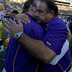 October 2, 2010; Baton Rouge, LA, USA; LSU Tigers defensive coordinator John Chavis (right) hugs assistant coach Joe Robinson on the field following a win over the Tennessee Volunteers at Tiger Stadium. LSU defeated Tennessee 16-14.  Mandatory Credit: Derick E. Hingle