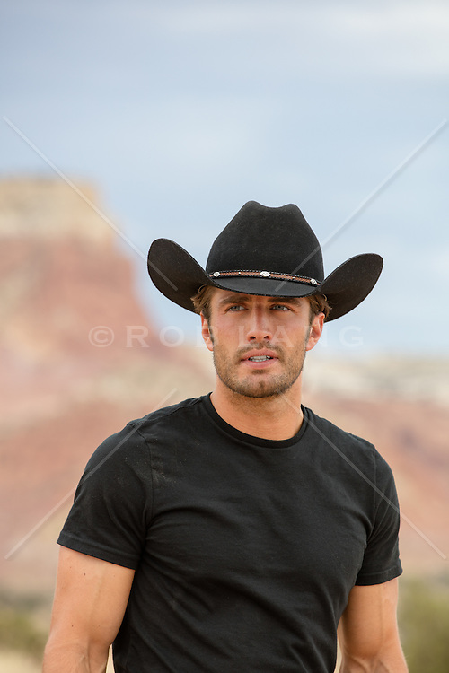 portrait of a rugged blue eyed cowboy outdoors