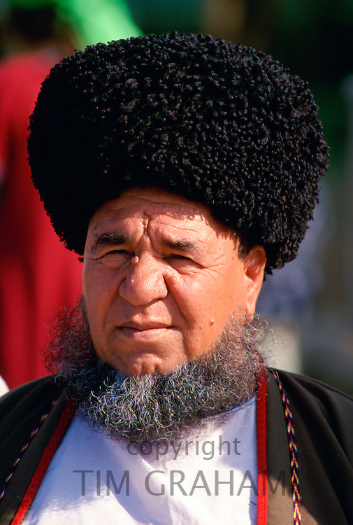 A man in a traditional hat in the city of Mary, Turkmenistan
